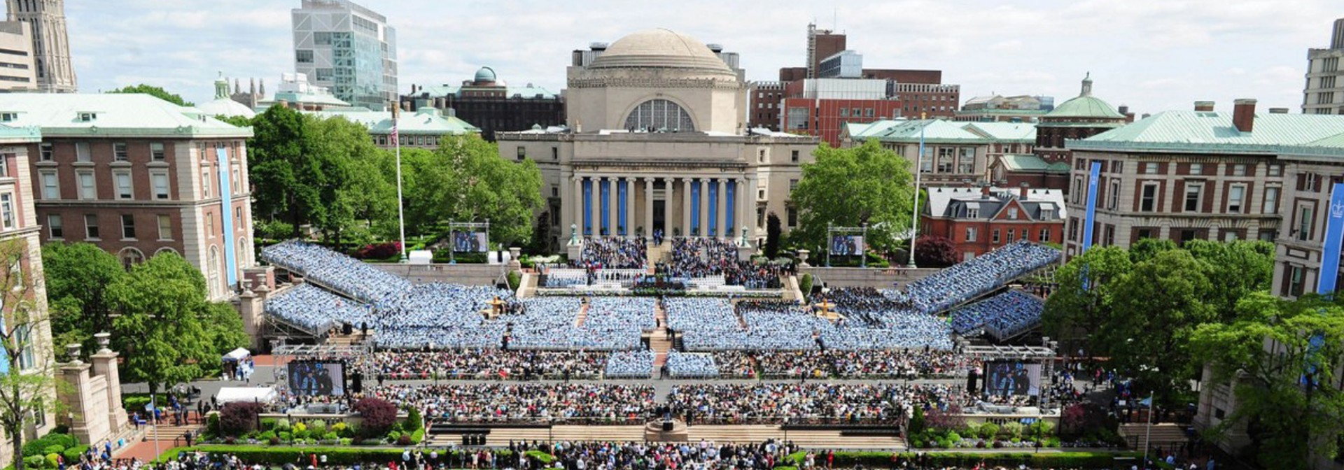 wide angle view of graduation at Columbia facing Low library